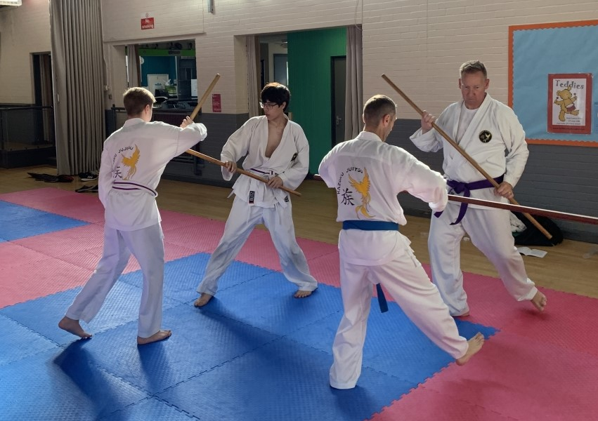 Students training with bo