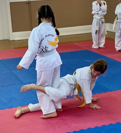 Girls performing a ju-jitsu throw